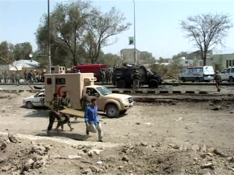 massive suicide car bomb ripped into a nato convoy killing six italian soldiers and 10 afghan civilians on thursday in one of the deadliest attacks... - kabul video stock e b–roll