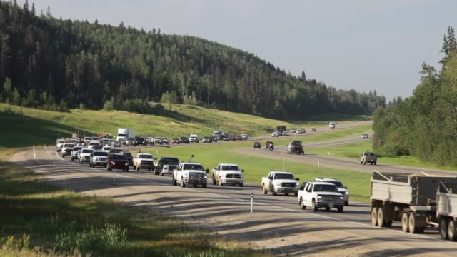 massive tailbacks on highway 63 north of fort mcmurray caused by tar sands workers at going home time. the alberta tar sands in canada are the... - oil industry stock videos & royalty-free footage