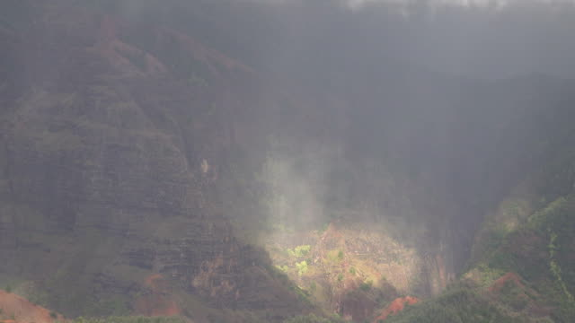 massive valley between mountains on kauai island in hawaii - butte rocky outcrop stock videos & royalty-free footage