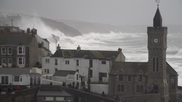 massive waves smash into the historic harbour and surrounding coastline as storm ciara coincides with high tide - storm stock videos & royalty-free footage