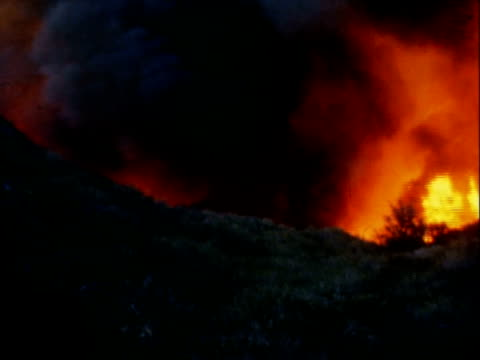 massive wildfire burning along california hills / thick black smoke searing flames / fire truck parked at foothills smoke rising wildfire on january... - foothills stock videos & royalty-free footage