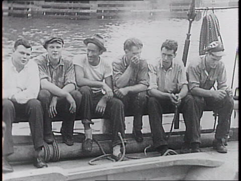 masted schooner philosopher in harbor / crew of six young men seated on ship's rail / close-ups of skipper arthur terry and a mr roberts, then terry... - brooklyn bridge stock videos & royalty-free footage