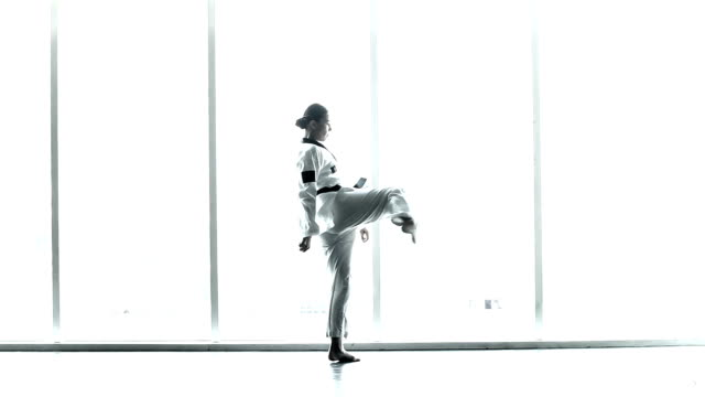 master black belt taekwondo woman teacher warm up in many pose, windows view silhouette figure - martial arts stock videos & royalty-free footage