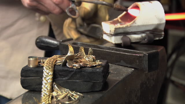 CU ZO Master jeweler using blowtorch to melt old jewelry pieces / Morton Grove, Illinois, USA