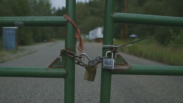 master locks and chain on gate of hazardous area, close-up - lock stock videos & royalty-free footage