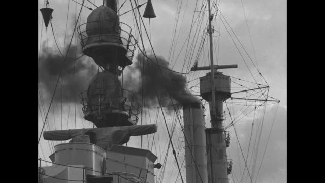 vídeos de stock, filmes e b-roll de masts and rigging of the german cruiser emden / starboard side filled with ships crew and officers on dock / anchor and heraldic emblem / smoke pours... - moving activity