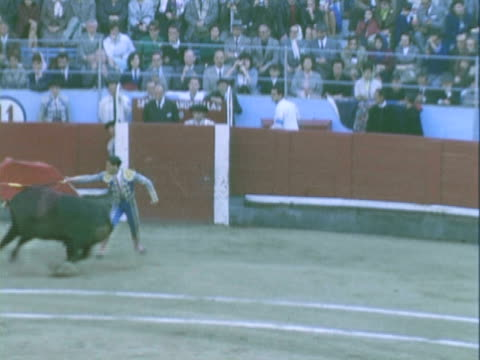 TS Matador challenging bull with red cape in the Plaza de Toros / Ronda, Malaga, Spain