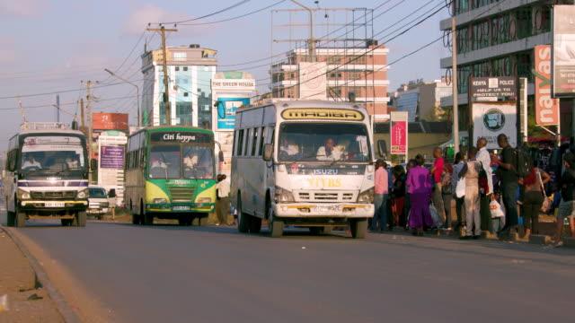 matatu arrives at & leaves bus stop ngong road, nairobi, kenya, africa - nairobi stock videos and b-roll footage