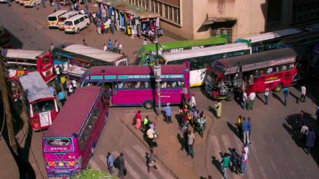 matatus at main stage bus station ronald ngala street, nairobi, kenya, africa - ナイロビ点の映像素材/bロール