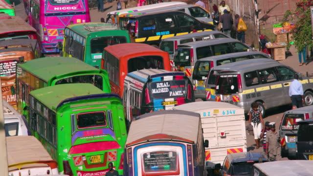 matatus at thika town stage bus station ronald ngala street, nairobi, kenya, africa - nairobi stock videos and b-roll footage
