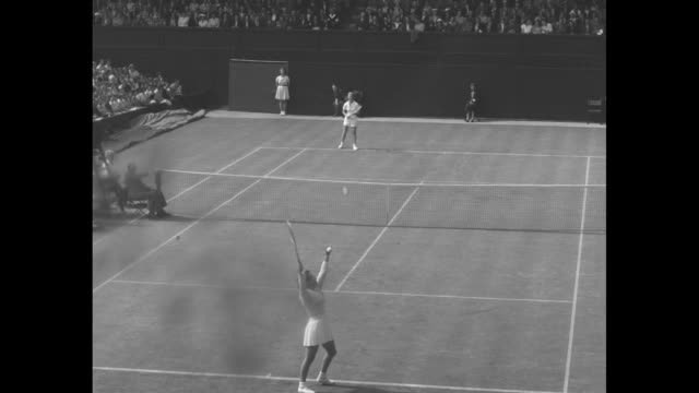 match at the all england lawn tennis and croquet club maureen connolly drops racket to settle first serve it goes to jean walkersmith / walkersmith... - tennis racket stock videos & royalty-free footage