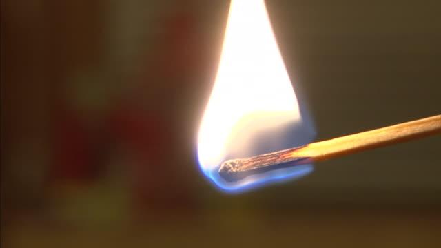 a match burns. - streichholz stock-videos und b-roll-filmmaterial