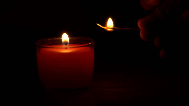 match igniting spa light candle - igniting stock videos & royalty-free footage
