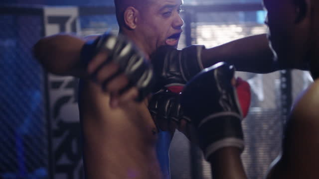 a match made in kickboxing heaven - cage stock videos & royalty-free footage