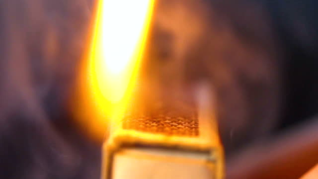 matches flaming by a man close up shot - streichholz stock-videos und b-roll-filmmaterial