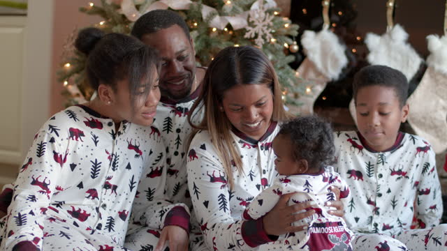 matching christmas onesies - pyjamas stock videos & royalty-free footage