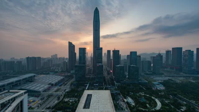vídeos y material grabado en eventos de stock de matching day and night downtown shenzhen, china - torre bank of china hong kong