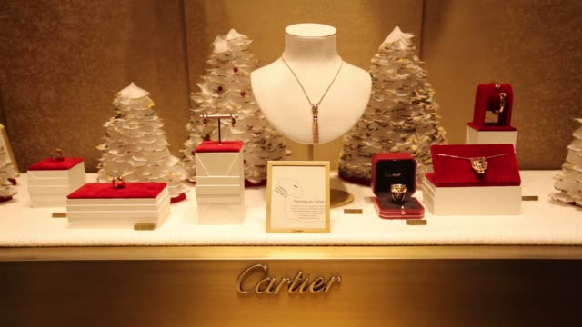 A matching gold Panther ring and necklace sit on display at the Cartier luxury jewelry boutique in Moscow Russia on Saturday Dec 19 2015