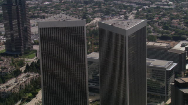aerial matching triangular-shaped skyscraper buildings / century city, california, united states - century city stock-videos und b-roll-filmmaterial