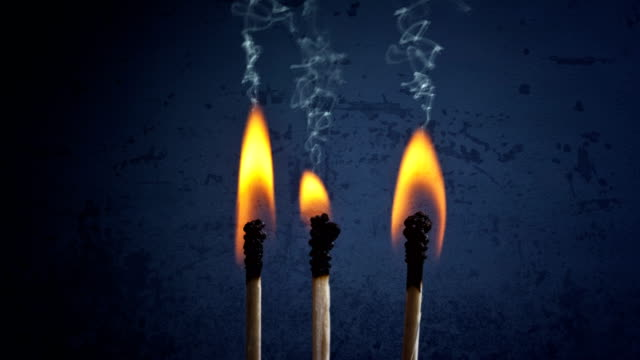 CINEMAGRAPH - Matchsticks with flame and smoke.