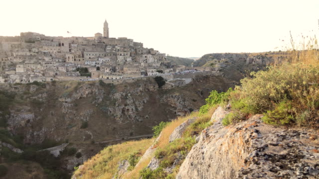 stockvideo's en b-roll-footage met matera at sunset, as seen from murga belvedere. - high key