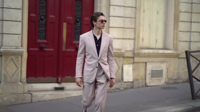 mathias le fevre wears a pink blazer jacket pants sunglasses a polo shirt outside pigalle during paris fashion week menswear spring/summer 2020 on... - pink shirt stock videos and b-roll footage