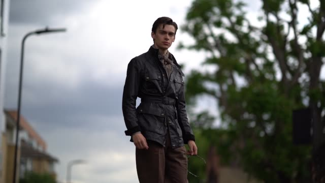 mathias lefevre wears a dark leather jacket a scarf brown pants brown leather shoes during london fashion week men's june 2019 on june 09 2019 in... - leather jacket stock videos and b-roll footage
