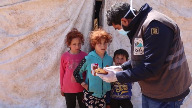 maths teacher muhammed ahmed lectures in front of a camera as part of distance learning measures to help children in syrian refugee camps continue... - refugee camp stock videos & royalty-free footage