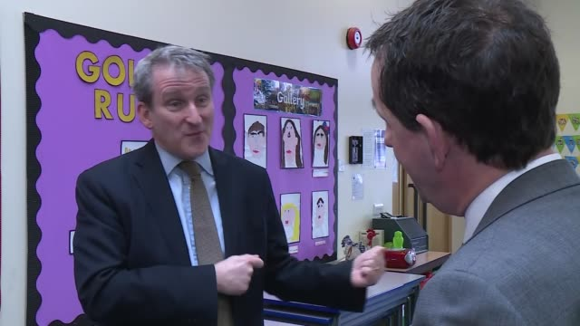 Thousands of primary school children to trial 'times tables check' Teeside INT Various of Damian Hinds MP sitting at small table talking with...