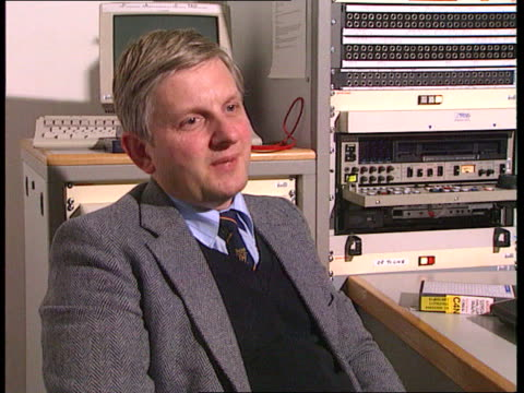 matrix churchill affair: revelations of blueprints; int england london itn bv capt tom hardie-forsyth watching tv pictures of shells in editing booth... - no doubt band stock videos & royalty-free footage