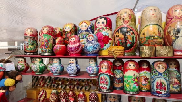 Matryoshka dolls / babushka dolls / vendor stand / souviner stand / customers buying gifts / Matryoshka Dolls on August 08 2012 in Moscow Russia