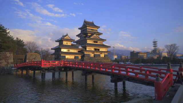 matsumoto castle with famous red wooden bridge landmark - japanese royalty stock videos and b-roll footage