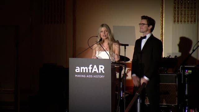 speech matt bomer and fergie duhamel give an award to francisco costa and italo zucchelli at the amfar inspiration gala new york 2014 at the plaza... - fergie duhamel stock videos and b-roll footage