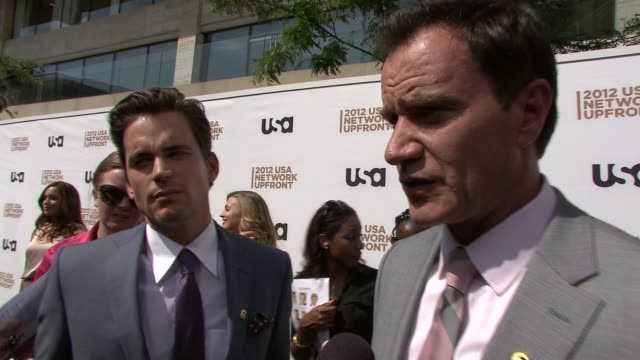 matt bomer and tim dekay on the success of white collar on what we can expect next season on the show's momentum on how they connect with their fans... - white collar worker点の映像素材/bロール
