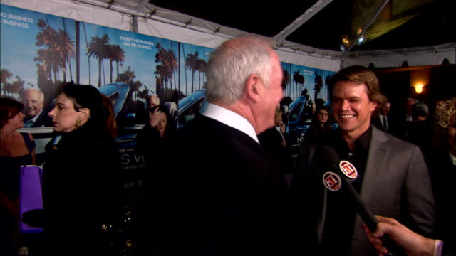 Matt Damon and Jerry Weintraub talk to reporter on the red carpet at Paramount Studios