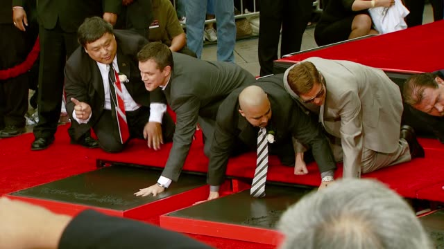 Matt Damon Brad Pitt Jerry Weintraub and George Clooney at the 'Ocean's Thirteen' Handprint and Footprint Ceremony at Grauman's Chinese Theatre in...