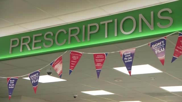 matt hancock visits a pharmacy in newcastle-upon-tyne; england: newcastle-upon-tyne: int gvs interior of high street pharmacy including close shot of... - prescription medicine stock videos & royalty-free footage