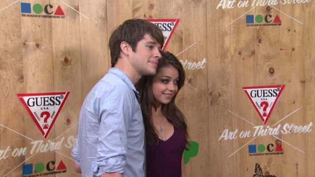 matt prokop sarah hyland at the guess moca host an evening of shopping at the third street promenade flagship store at santa monica ca - sarah hyland stock videos and b-roll footage