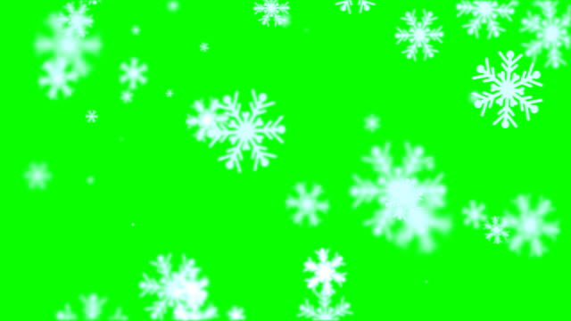 matte - chroma key of snowflakes falling down loopable winter / christmas background - snowflake stock videos & royalty-free footage