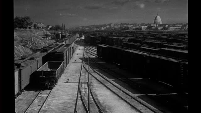 matte special effects rail yard matte painting of washington dc applied to establishing shot of rail yard / transition seen with clapboard matte... - 操車場点の映像素材/bロール