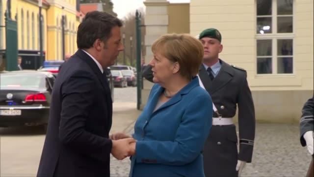 Matteo Renzi tenders his resignation over referendum result LIB / Hanover Renzi out of car and greeting Angela Merkel G5 Leaders along on balcony...