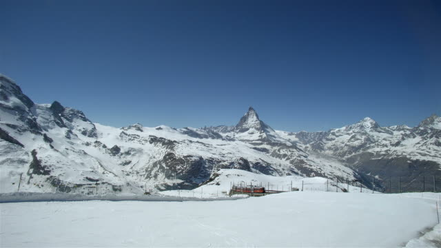 Matterhorn and Skiing with Train in Distance