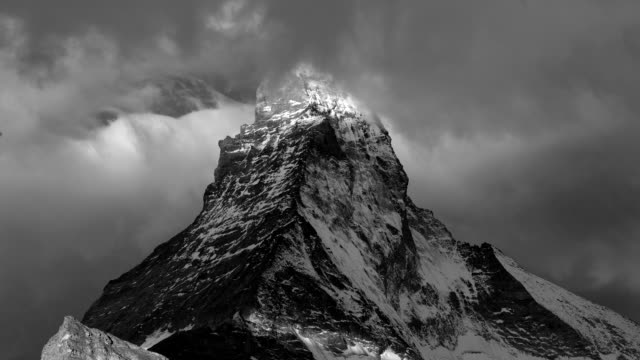 matterhorn mountain, close up of peak, time lapse of moving clouds and sunbeams, zermatt, switzerland, 2 of 4 - black and white stock videos & royalty-free footage
