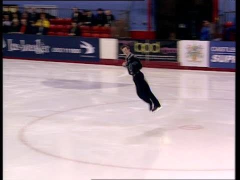 vídeos y material grabado en eventos de stock de matthew davies attempts jump but misses landing and falls over, british figure skating championships, belfast; nov 99 - esterilidad