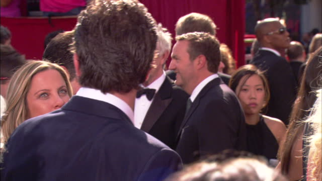 CU Matthew Perry walking through crowd and talking to unidentified woman on red carpet at Nokia Theater