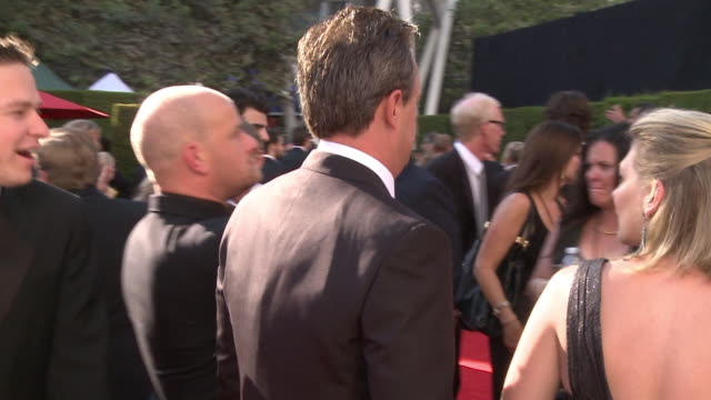 Matthew Perry walking through crowd down the red carpet and waving as his name is called at the Nokia Theater LA Live