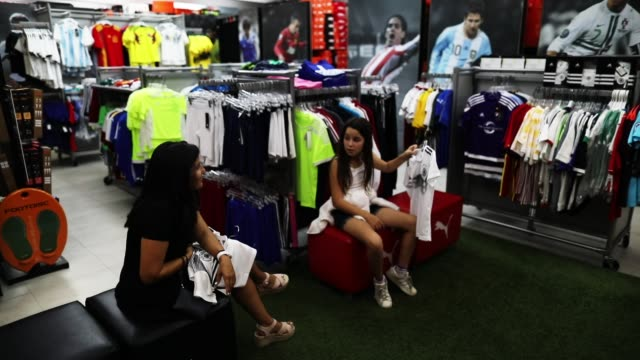 matthias meyer, mia meyer and their mother vanessa meyer shop at the soccer locker store for german soccer team items as they prepare to show their... - sports clothing stock videos & royalty-free footage