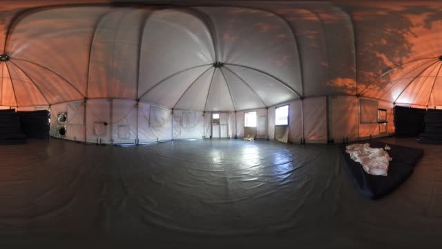 'Mattress pads sit stacked in an empty tent at the Immigrant Respite Center on March 16 2017 in McAllen Texas The center located in McAllen's Sacred...