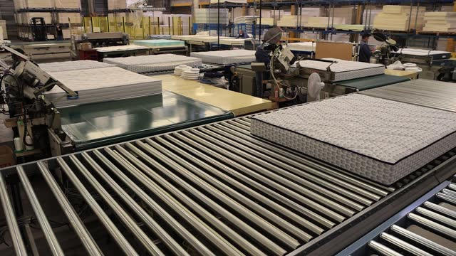 mattresses move on treadmills at dunlopillo brand bedding factory on march 24, 2021 in limay, france. the ile-de-france region provided 800,000 euros... - conveyor belt stock videos & royalty-free footage