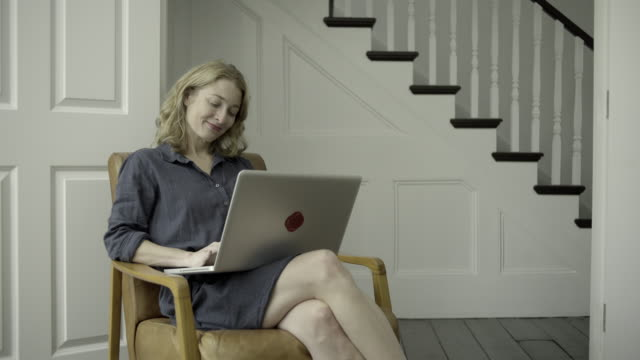 Mature Adult Female working from home on laptop